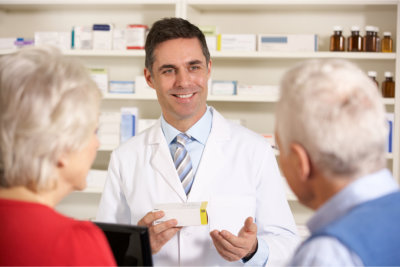 pharmacists and elderly couple
